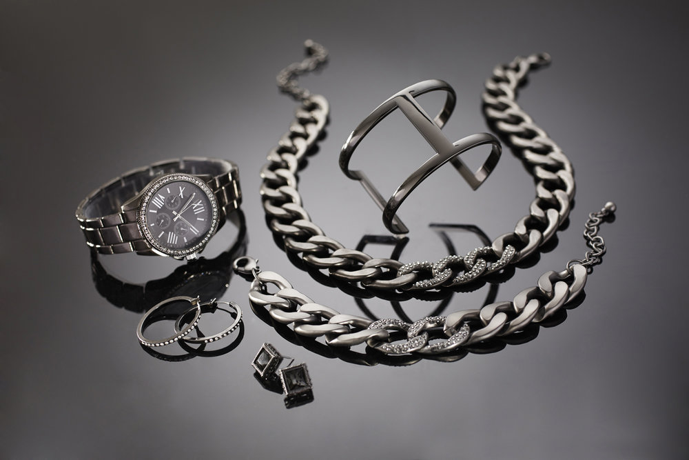 retouched gray titanium jewelry set with watch, necklace, bracelet, and earrings