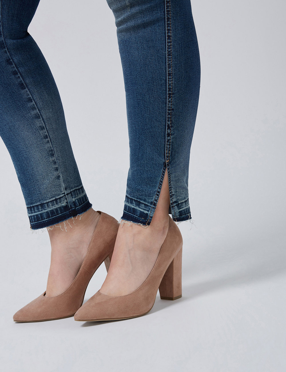 retouched ankle shot of split cuff jeans with unfinished hem