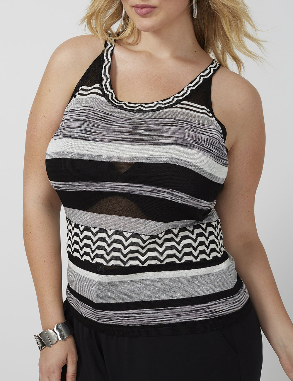 blonde fashion model wearing black and gray striped tank top
