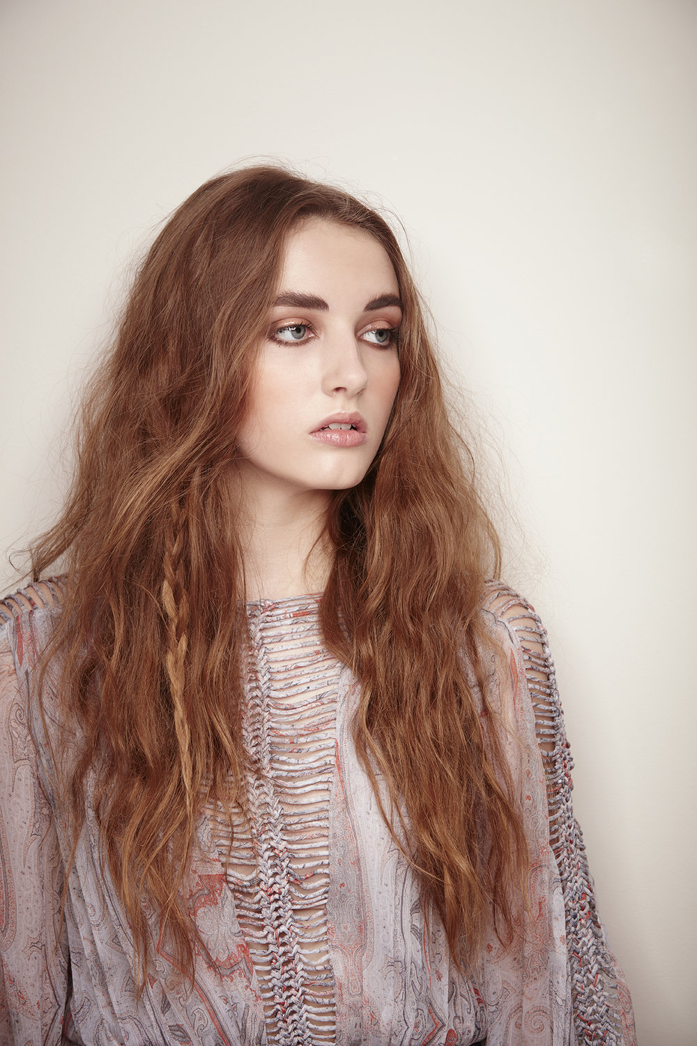retouched wavy-haired model in boho dress