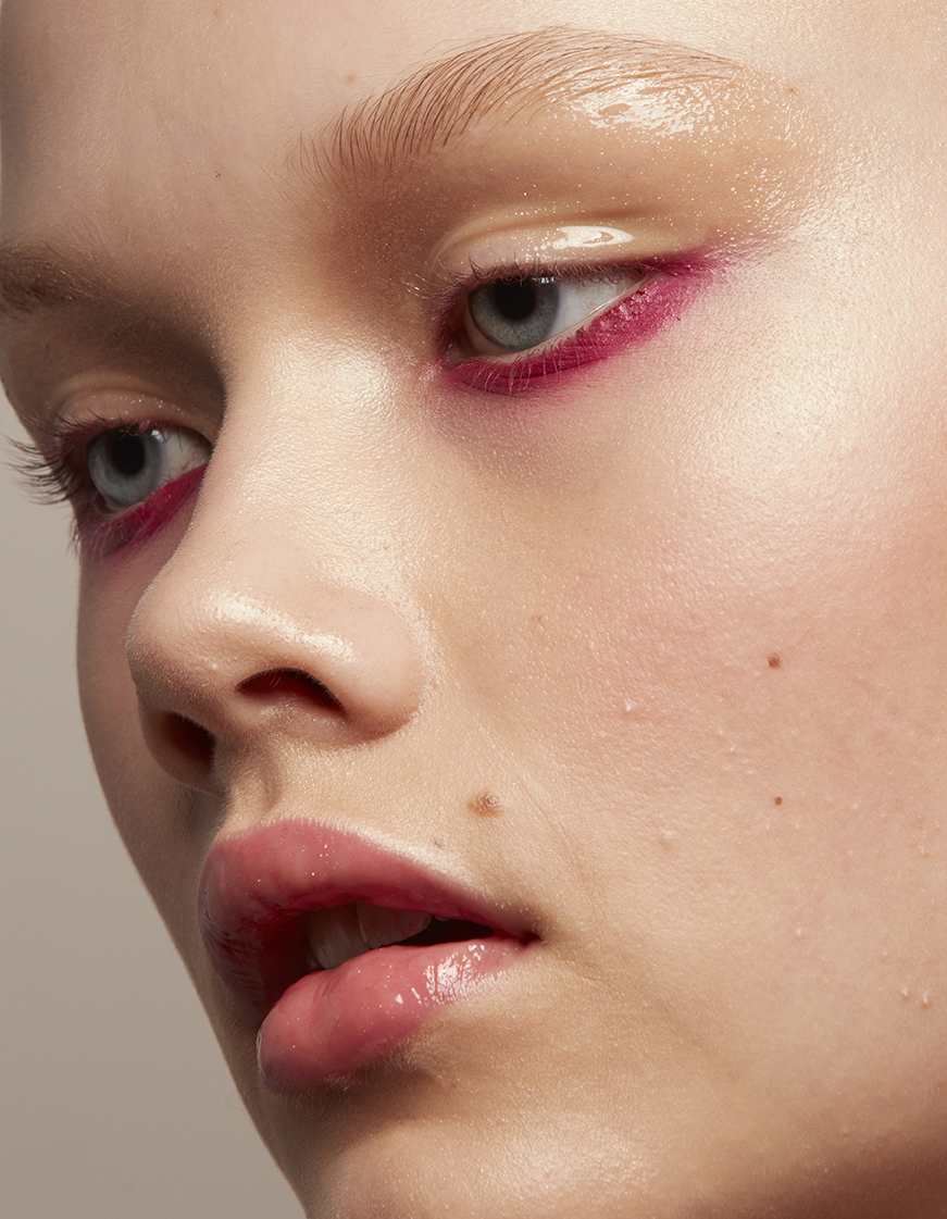 closeup of woman wearing bright magenta eye makeup
