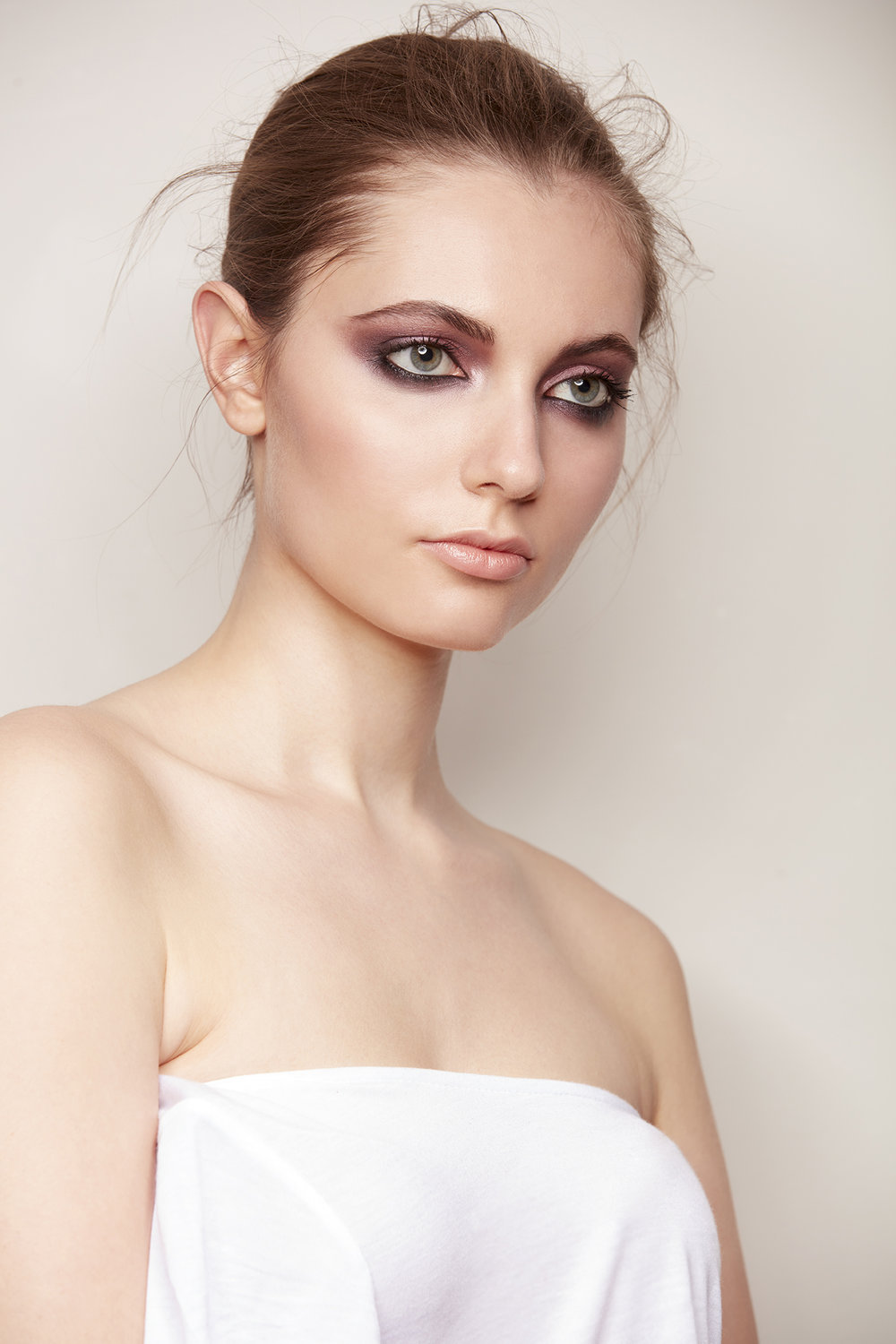 retouched woman with hair up wearing dark smoky eyeshadow