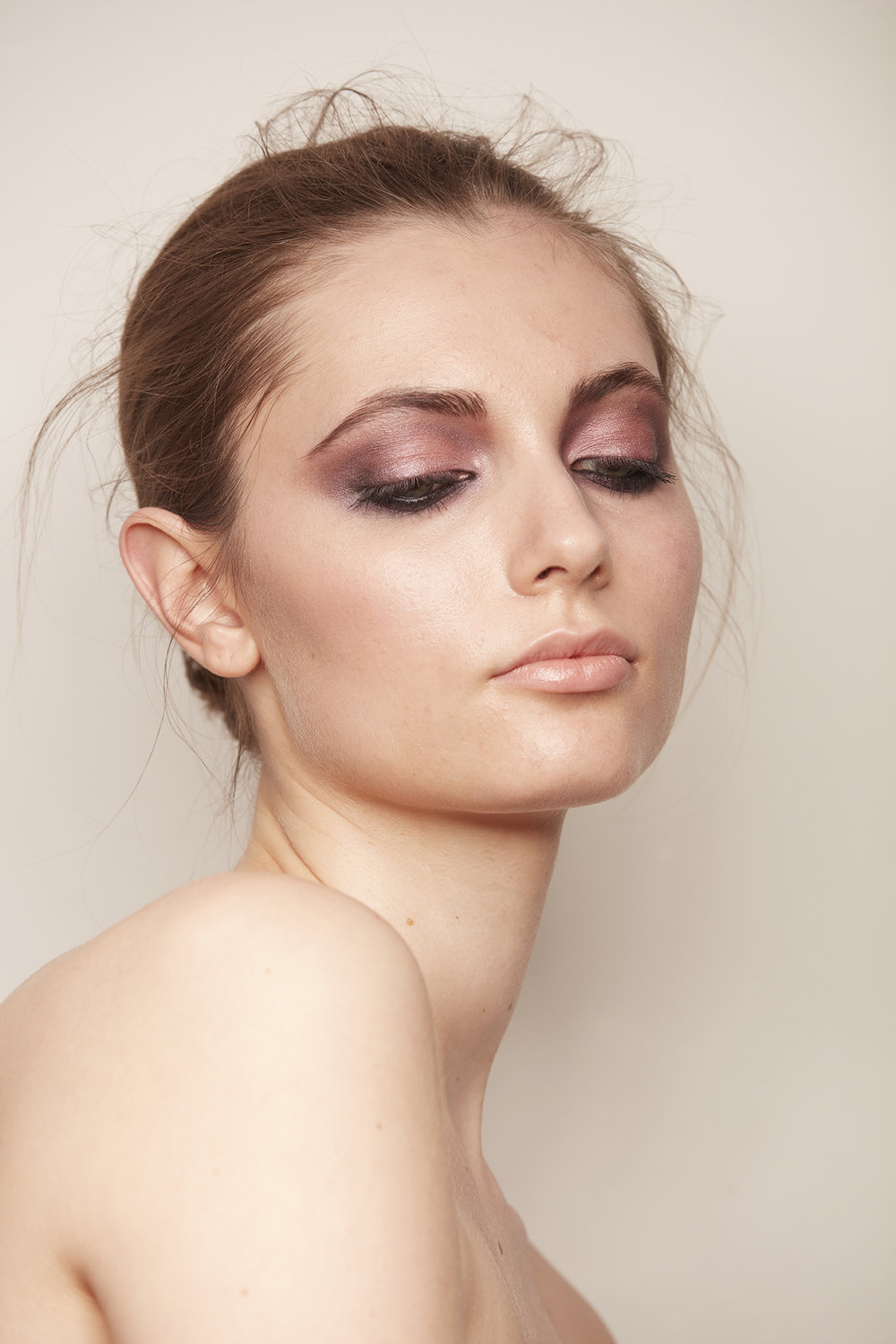 closeup of woman with shimmery rose quartz eye shadow and black eyeliner