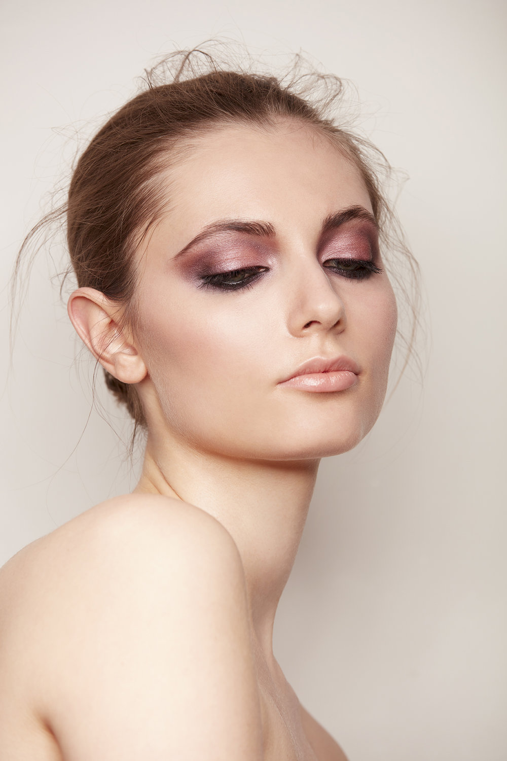 retouched closeup of woman with shimmery rose quartz eye shadow and black eyeliner