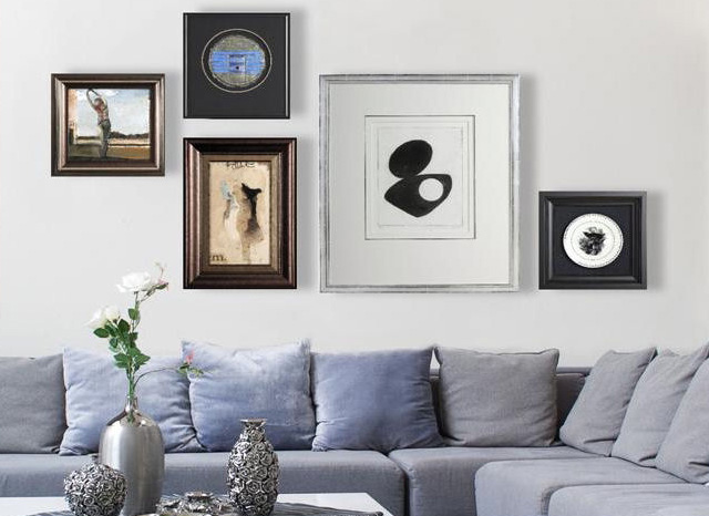 an arrangement of wall art in living room