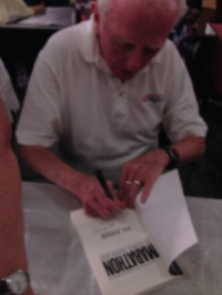 Hal Higdon signing a book for me! I was so excited to meet him! check out his training plans at  www.halhigdon.com