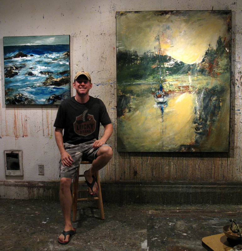 Me in the art studio with recent paintings.