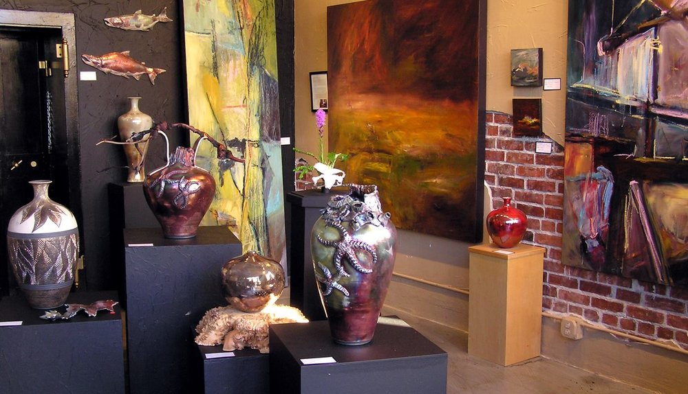 Years ago when I still showed my hand-thrown Raku pottery with my paintings.