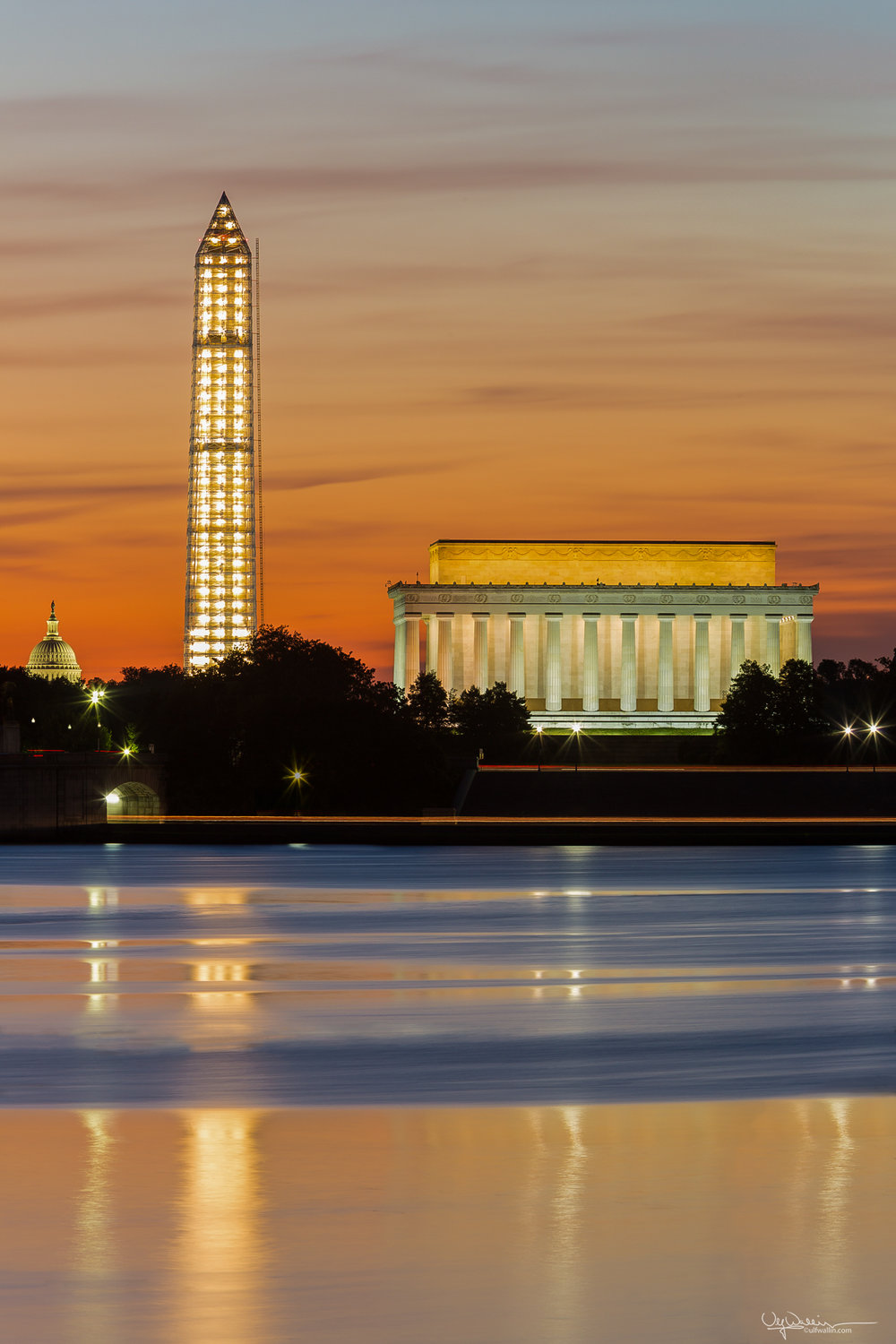 Three iconic DC landmarks at dawn, Lincoln Memorial, Washington Monument and Capitol Dome. Part of series showing Washington Monument being repaired from earthquake.