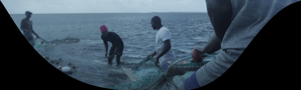 A frame of Mozambique fishermen from one of the center screens.