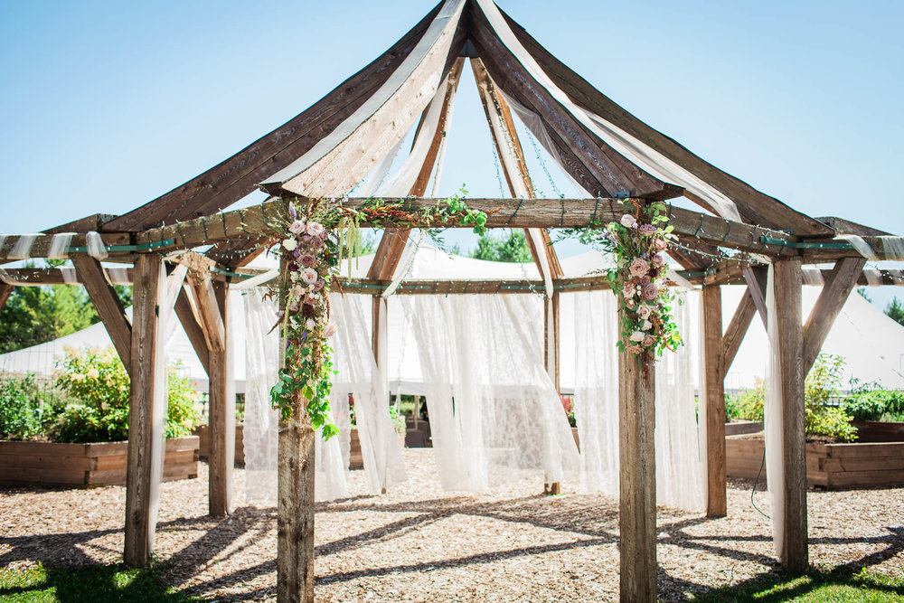 Folklore Flowers arbor decoration at Garden Gables wedding venue!