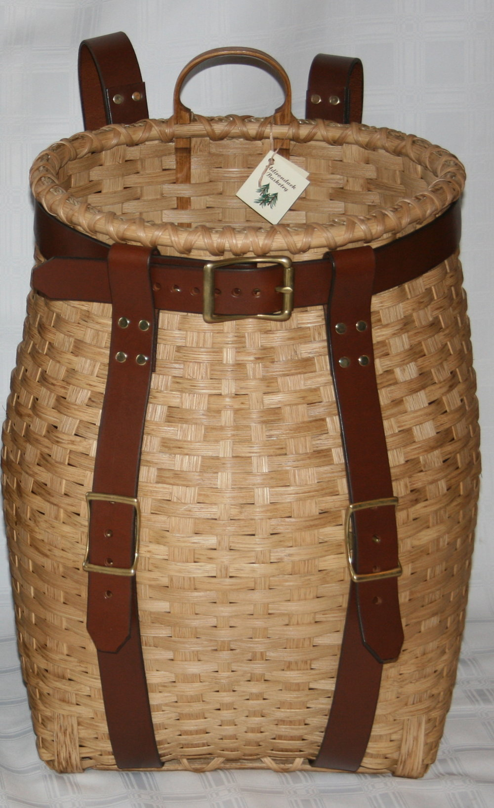 July 13-15, 2018 Large Mountaineer Pack Basket - One of the most recognized objects associated with the Adirondacks.  These versatile baskets were used to carry just about everything the guides, hunters, and trappers took with them into the woods.  Create your very own in this 2-day workshop with renowned basket maker Linda Scherz.  Harness choice (cotton or leather) needs to be made two weeks prior to class to allow for ordering and making. Once enrolled, Linda will contact you regarding the leather harness fee (cotton harness is included in the materials fee).  Baskets will not be stained during class.Our Weekend Package includes lodging, all meals, the 2 day workshop, and all basket materials and instruction.  Cost for the Weekend Package is $565 per person.Local participants can also register for the workshops only (Saturday 9 am - 5 pm and Sunday 9 am - 4 pm) for $200, which includes all basket materials, instruction, and lunch both Saturday and Sunday.Class size is limited, so register early!  Call our registrar at 315-354-5311  ext. 1021.