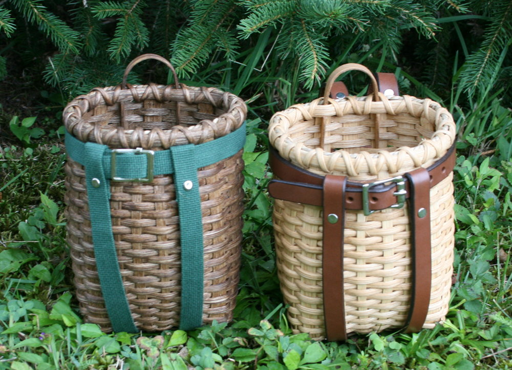 baby pack basket with cotton webbing (left) and leather HARNESS (right)
