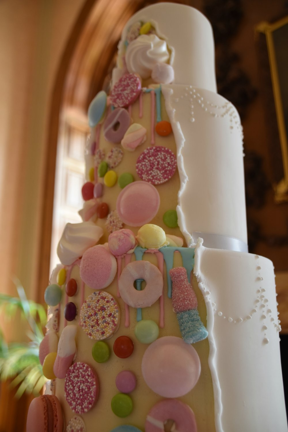 A playful design we set up for an Ashridge House wedding, with half fondant and half white chocolate ganache