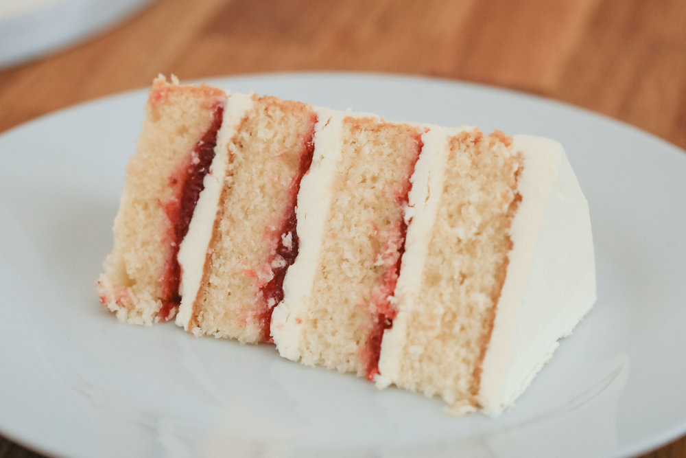 A slice of our signature, tender, Victoria Sponge. Photography by  Becky Harley Photography