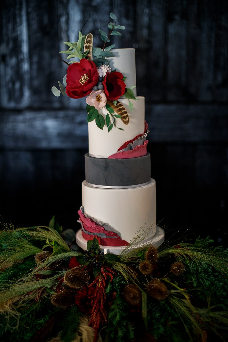 South Farm Wedding Cake by Meadowsweet Cakes, dressed with Burgundy Sugar Flowers and Ruffles. Photography by Lina and Tom