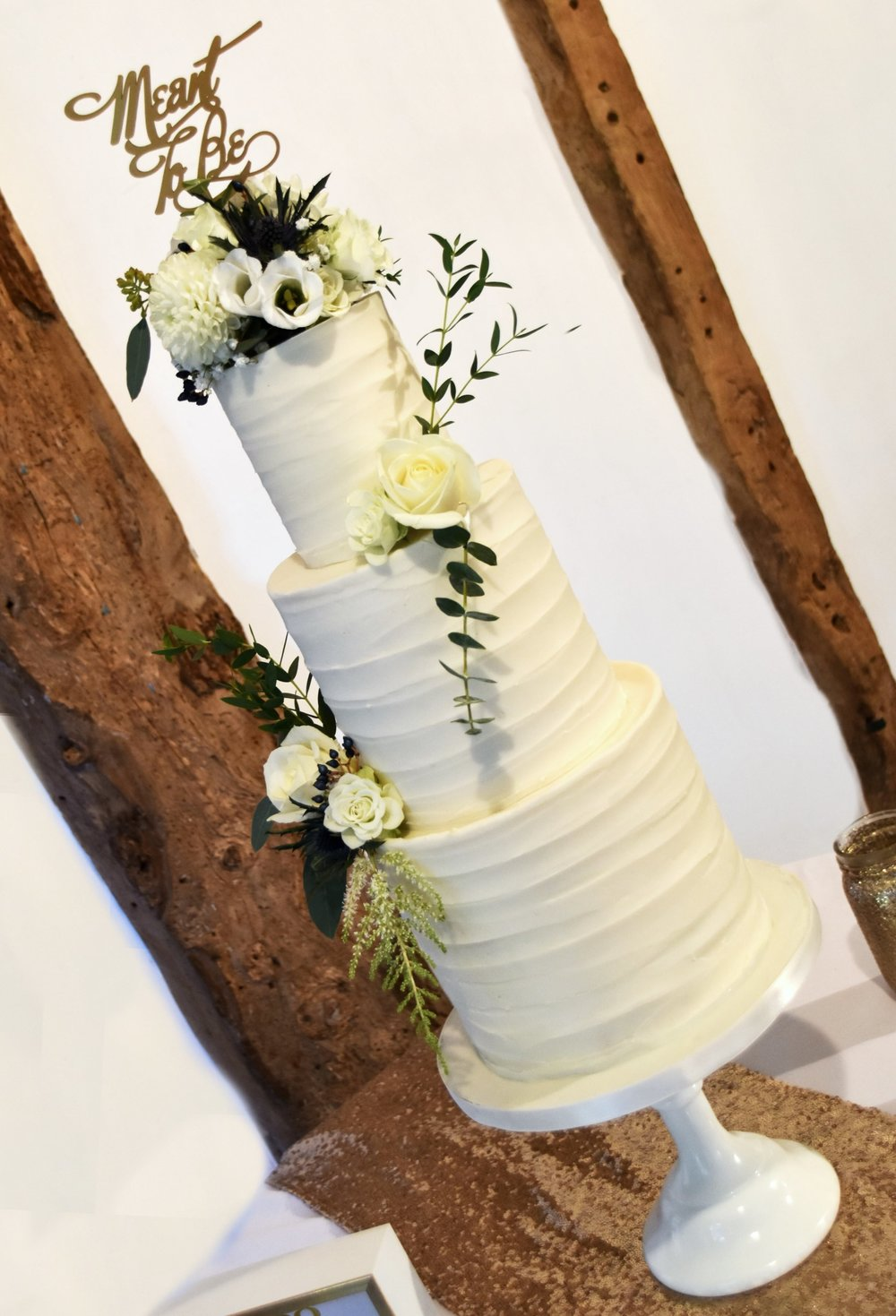 Texture buttercream wedding cake with fresh flowers, Cake by Hertfordshire wedding cake company Meadowsweet Cakes, set up at South Farm
