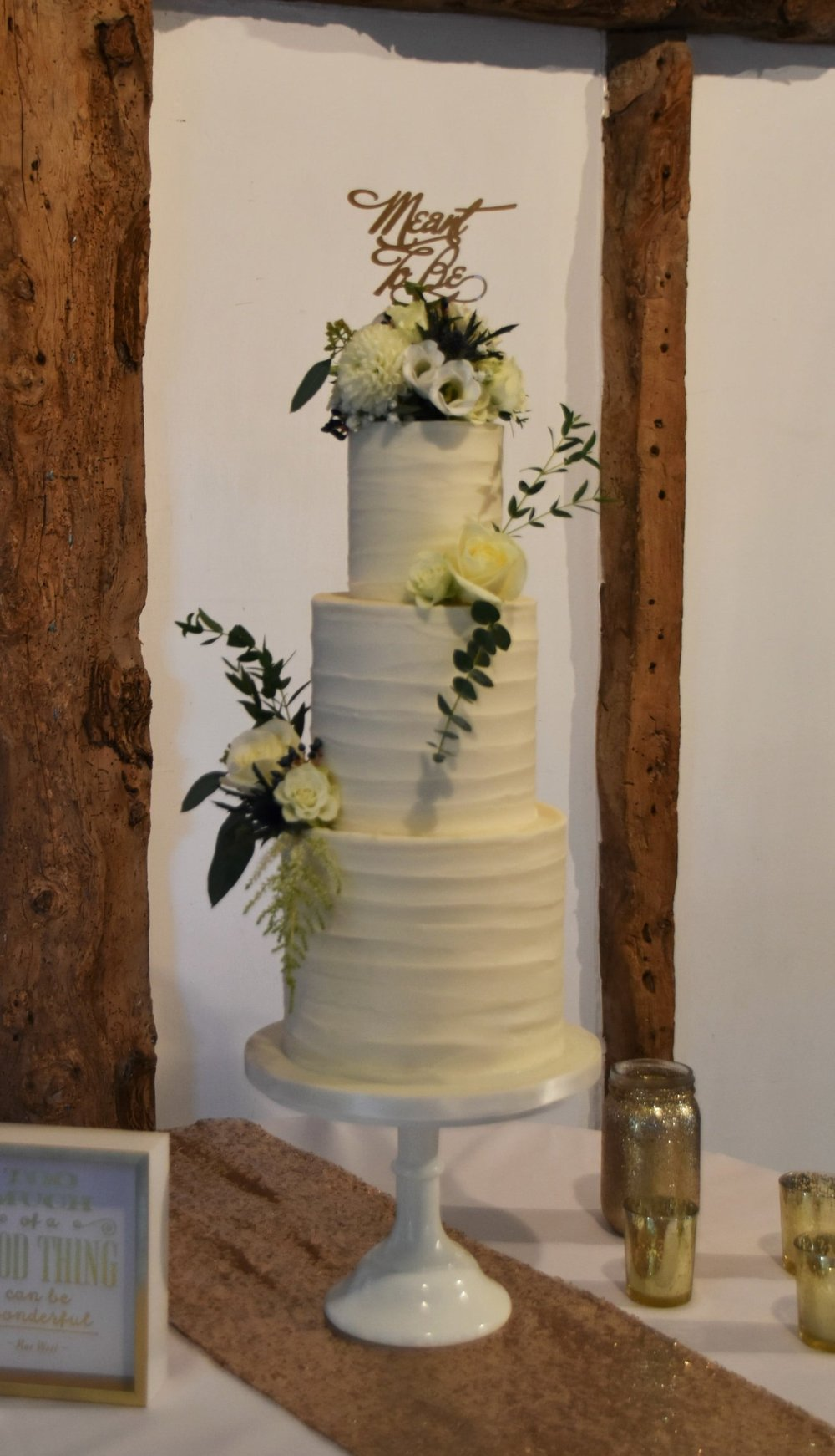 Textured buttercream wedding cake set up at South Farm, Cambridgeshire by Meadowsweet Cakes