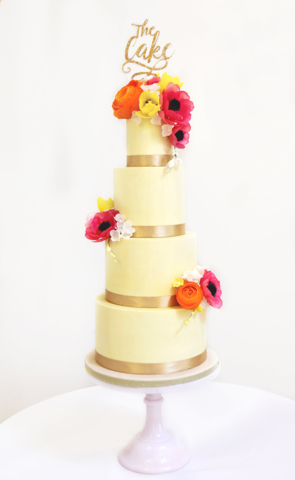 This cake was fully iced in white chocolate ganache for a wedding at Bassmead Manor Barns. You couldn't even tell it wasn't fondant! Cake by Meadowsweet Cakes