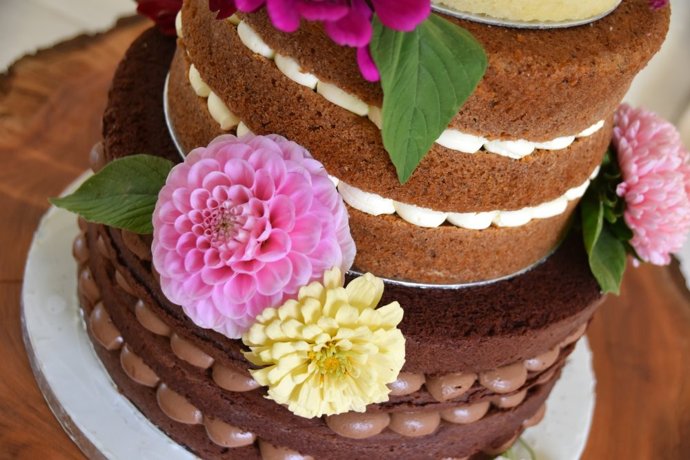 A vegan, naked wedding cake by Meadowsweet Cakes.