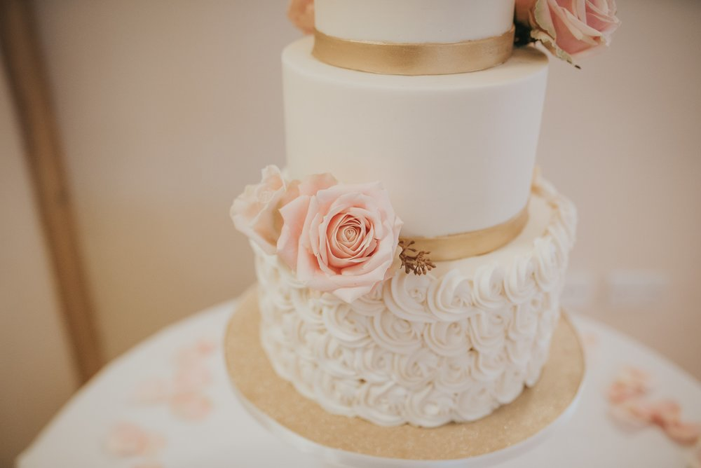 All buttercream wedding cake, smooth tiers and a rosette buttercream bottom tier. Photography by Tom Halliday, Cake by Meadowsweet Cakes.
