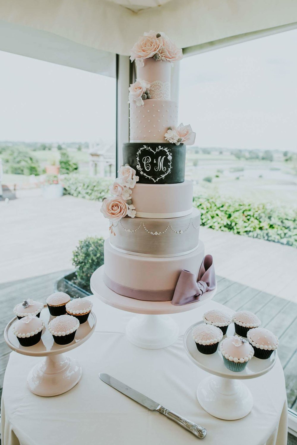 Beautiful fondant wedding cake by Meadowsweet Cakes, set up at The Old Hall Ely