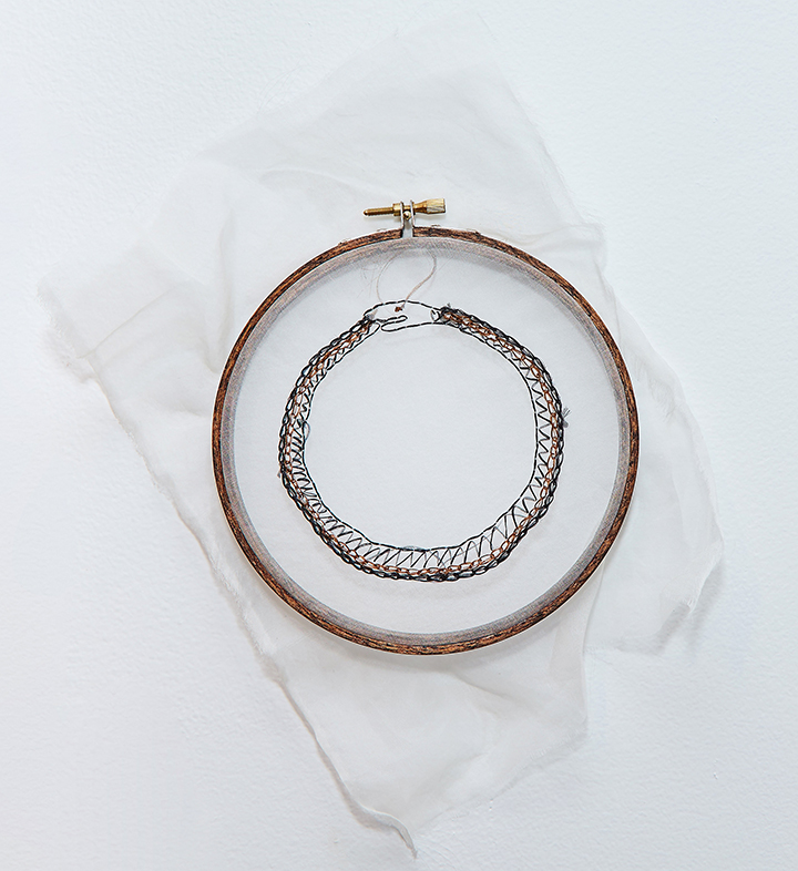 "Ouroboros , 2016 | Human hair on silk organza in wooden embroidery hoop | 13"" x 10"""