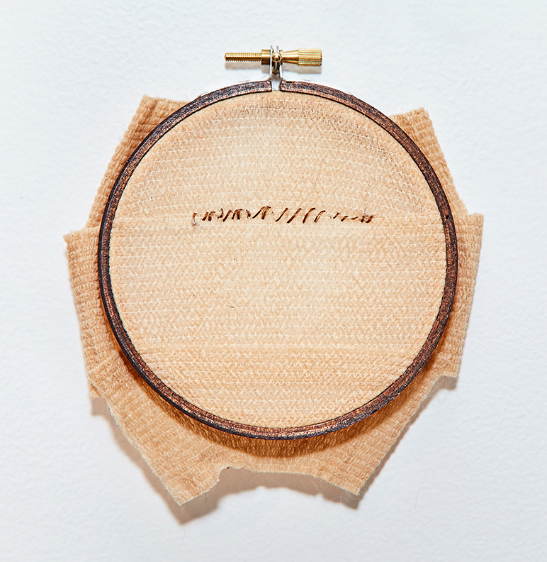 Incision , 2016 | Human hair, bandages in wooden embroidery hoop