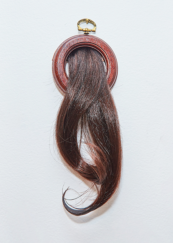 "Ponytail 1 , 2016 | Synthetic hair, beeswax, wooden frame | 9"" x 3"""