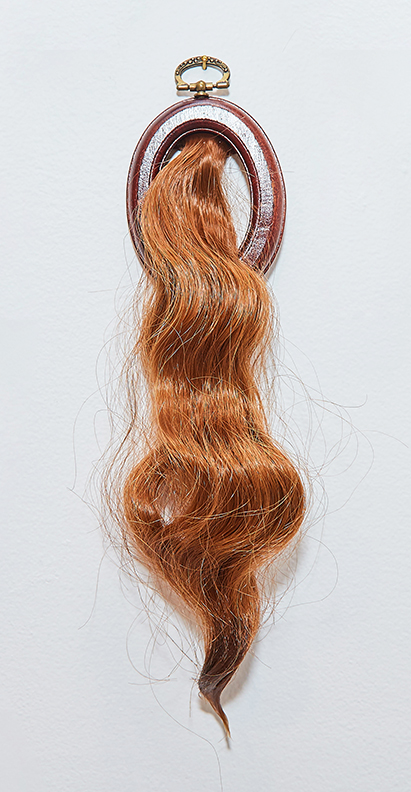 "Ponytail 3 , 2016 | Synthetic hair, beeswax, wooden frame | 9"" x 3"""