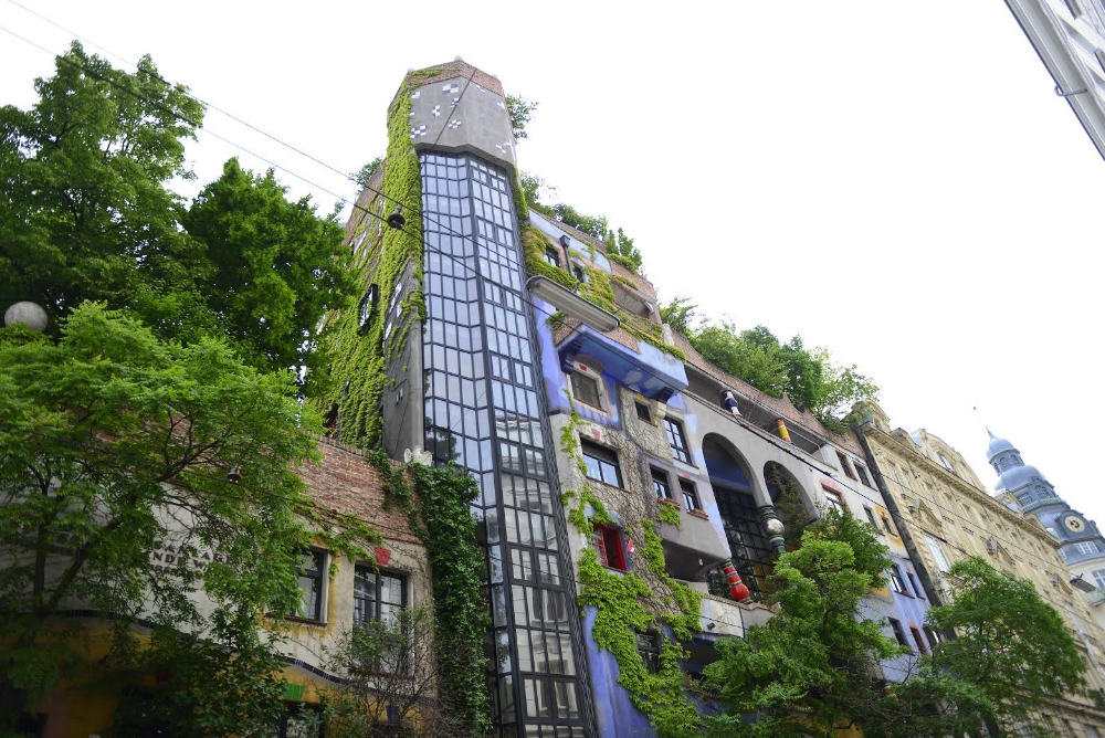 """Vienna has some of the most interesting architecture. I loved seeing the works of Hundertwasser, an architect known for championing for greenery, """"forests"""" on the roofs (so people can milk their goats whenever they please), and for the ability for people to reach out their windows to paint their space as they wish. The spontaneity of the colors and vegetation I found to be enchanting."""
