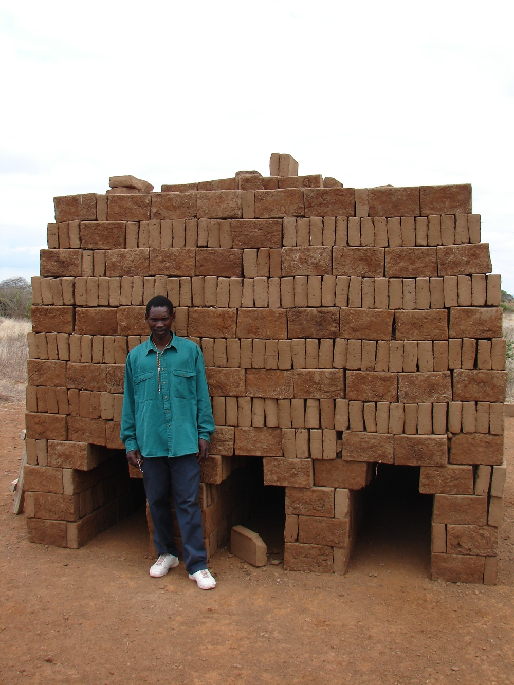 Clay bricks cut from the ground and stacked in preparation to be fired