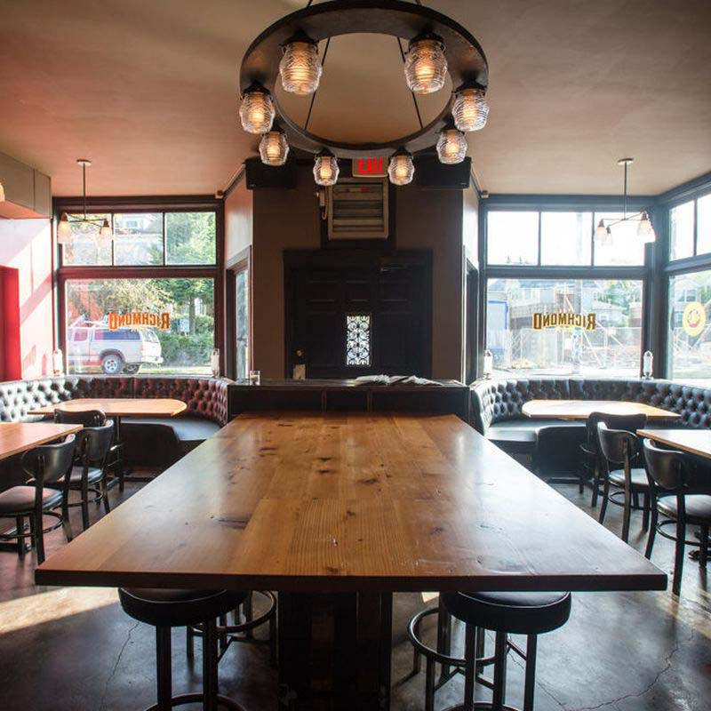 The Richmond - The transformation is complete at SE Division's former Matchbox Lounge space: Olympic Provisions/Clyde Common mastermind Nate Tilden and longtime Clyde GM Nick Gusikoffdebuted their British-pub-meets-Restaurant-Row watering hole, the Richmond Bar, located a stone's throw from Pok Pok and Ava Gene's. The space combines some familiar PDX-bar aesthetics (hand-worked steel and leather bar stools, wood tabletops) with tufted booths, white tile, and an eye-popping wallpaper sourced from the UK's Select Wallpaper.
