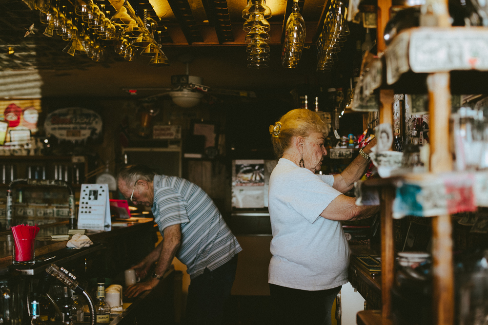Wendall and Jane Southhall take turns in bartending and dishwashing duties during the day.