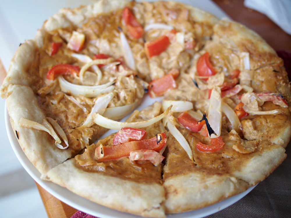 Panang Curry Pizza with onions and red bell peppers