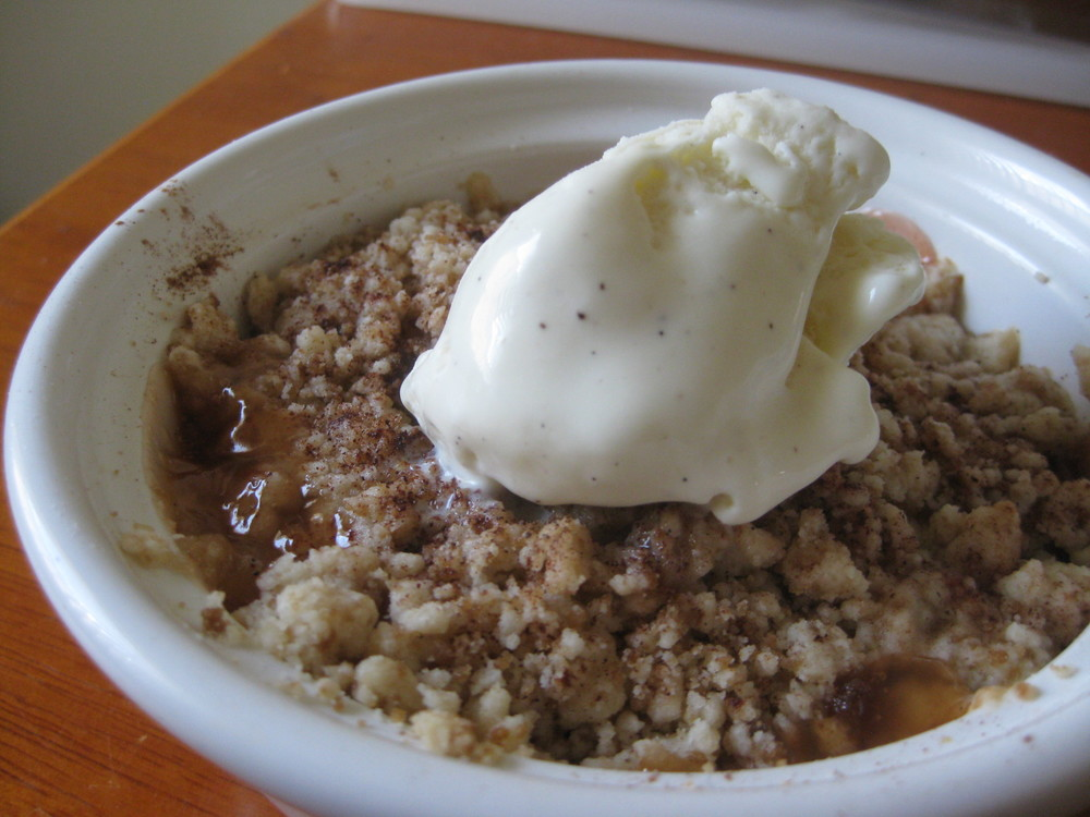 Amaretto peach crisp with vanilla ice cream