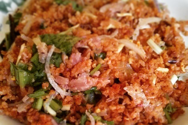 You can find wonderful gems like this Yum Nam Khao Tod (Crispy Fried Rice Salad with Sour Sausage) if you go off the beaten menu path and support a local Thai restaurant.