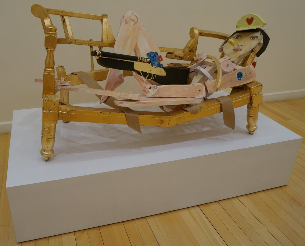 Rodney Pople Olympia 2015 Painted and gilded wood, shot gun shell, furniture strapping 73 x 140 x 72cm courtesy of the artist & Australian Galleries $12500 including commission and GST
