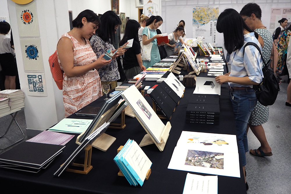 Books by Norwegian artists and publishers are being displayed on one table...