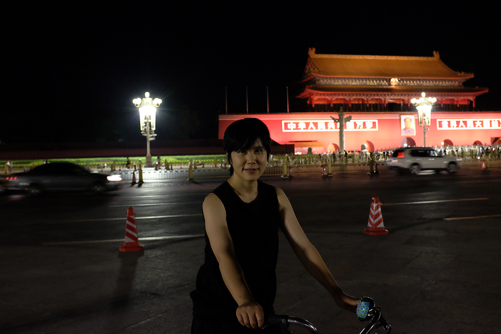 Project leader Yilei in front of Tiananmen Square