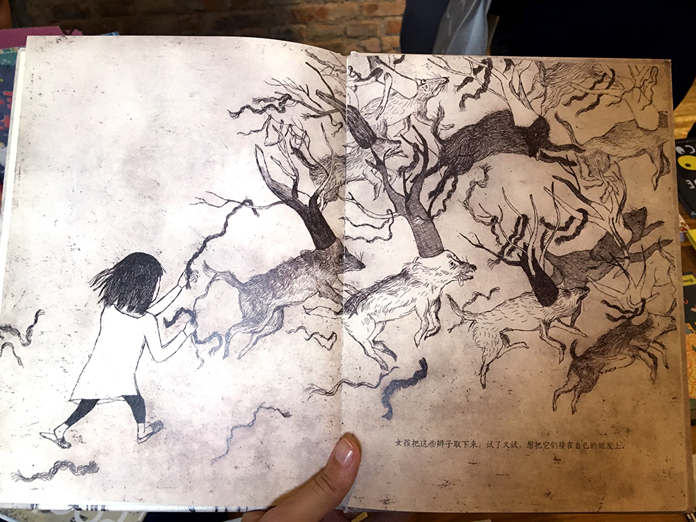 One of Xiong Liang's students, Mi He, made this  amazing  children's book using etching. The story is about a girl who has to chop off her long hair so that her family can sell it. In different ways she tries to make new, long hair for herself. This is from a nightmare she has. The book is based on a true story, too!