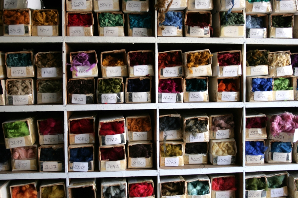 Coded samples of dyed wool. Each yarn is made from a blend of up to five colours. A unique 'recipe' is written up for each yarn.