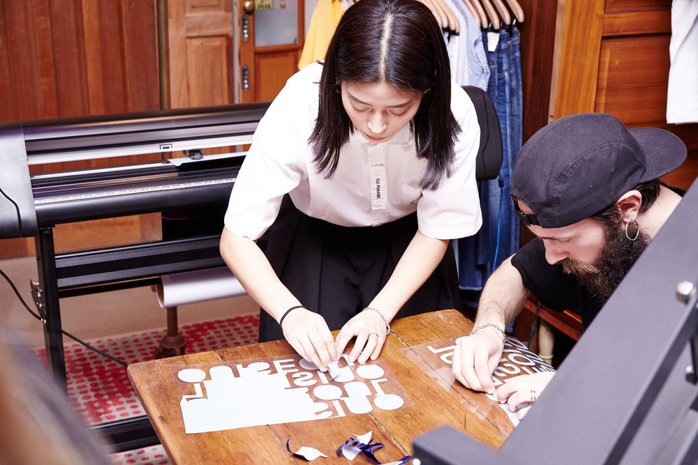 Korean-French duo designer brand Oui Paname heat pressing 'Our Seoul' logo onto t-shirts