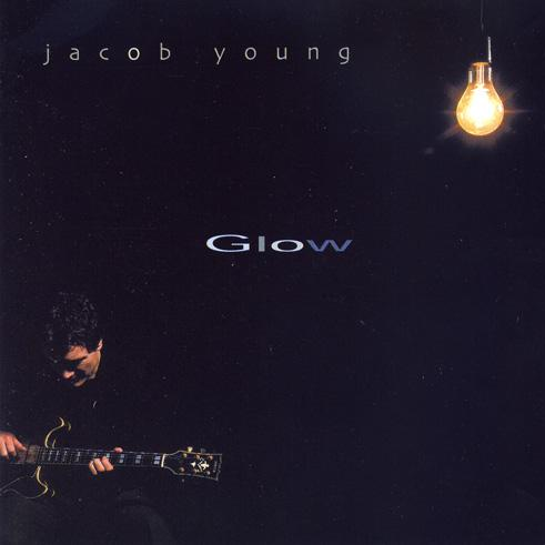 Glow - again Jacob releases new songs in a jazz format, but this time uses the studio as a tool, the musicians that participate on this album is a who is who of Norwgian jazz in the year 2001. His second album for Curling Legs. Musicians; Jarle Vespestad, Trygve Seim , Arve Henriksen, Knut Reiersrud, Bendik Hofseth, Håkon Kornstad, Vigleik Storaas, Christian Wallumrød, Audun Erlien, Mats Eilertsen, Reidar Skår, Øyvind Brække. Buy