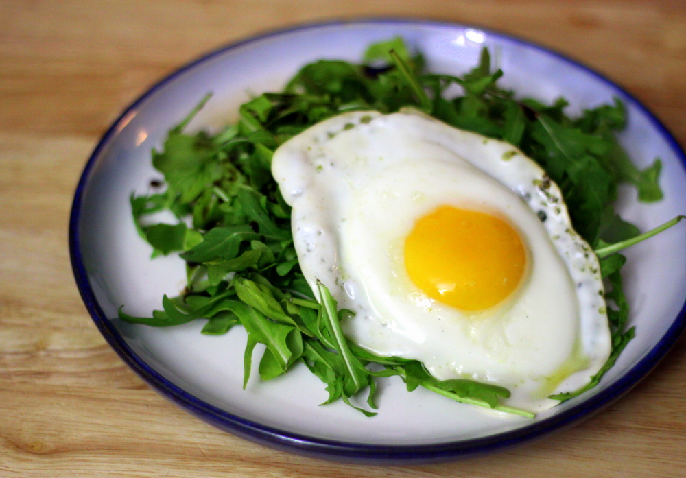 fried egg on greens