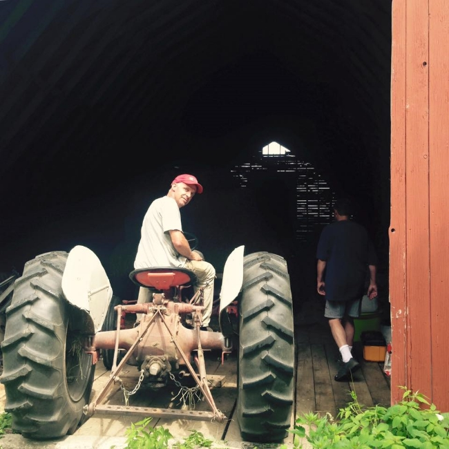 Putting the tractor away - photo credit, Elena Gustavson