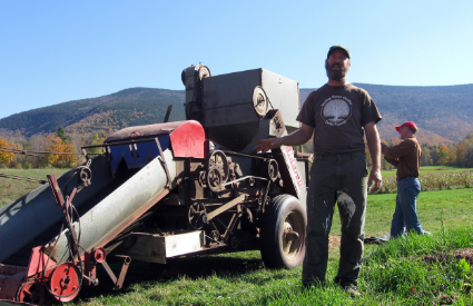 Ryan Yoder alongside his bean thresher