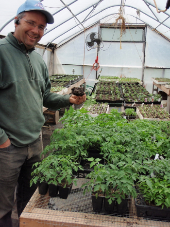 Stephen Chamberlain in one of his greenhouses. Photo courtesy of Dutchess Farm