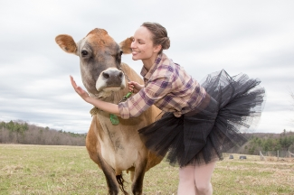 Dancer Megan Stearns alongside a farm friend. Photo by Joey Jones