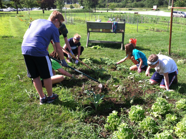 Participants of Rutland Grows, RAFFL's garden education program, tend to a garden in 2013.
